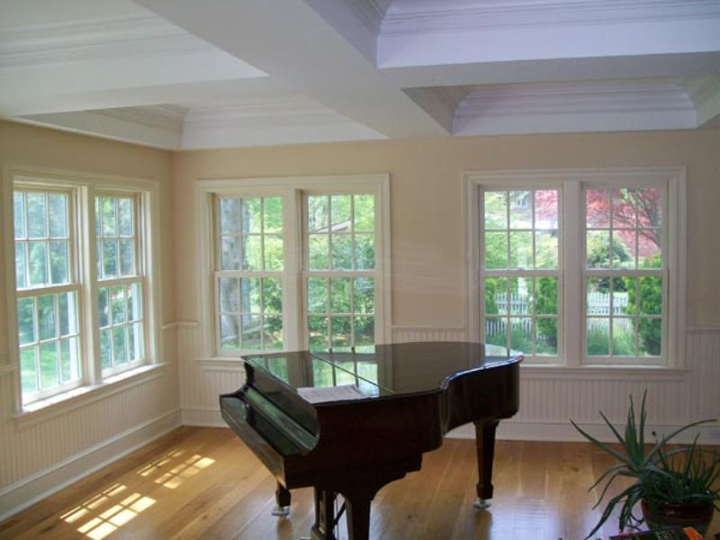 room with piano and windows