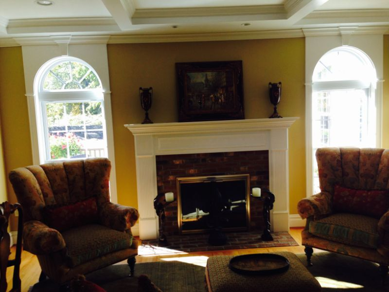 living room with fire place and chairs