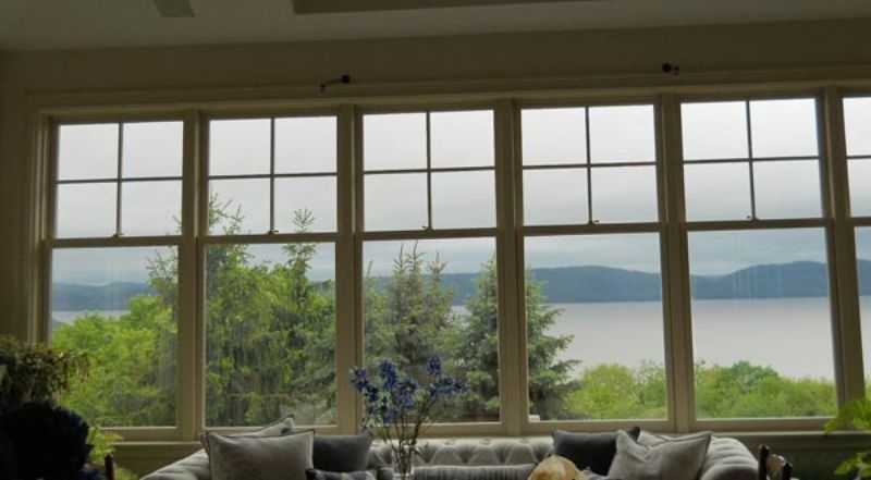 view of water and mountains from windows